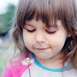 Little Girl Blowing on Dandelion — Stock Photo