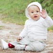 Baby Boy Sitting on the Ground — Stock Photo #7185599