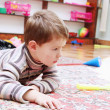 Stock Photo: Little Boy Playing in Nursery