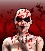Sangue coperto psico clown femminile soffia un bacio — Foto Stock