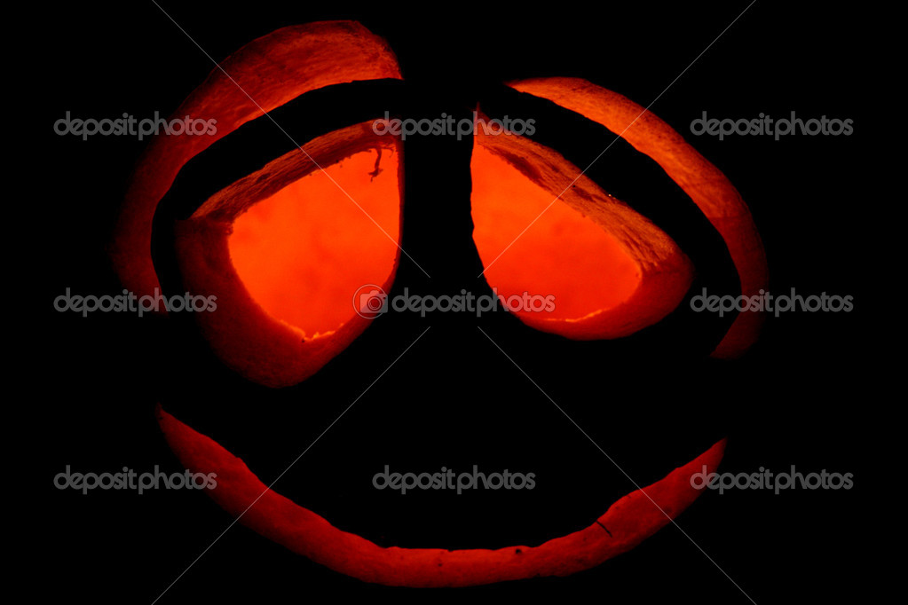 Halloween pumpkin at an entrance to a house in darkness   #6849850