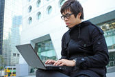 Man using computer outdoor — Stock Photo