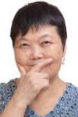 Old asian woman thinking — Stock Photo