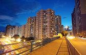 Modern urban city at night with freeway traffic — Stock Photo