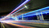Megacity Highway at night with light trails — Stock Photo