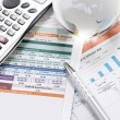 Financial charts and graphs on the table — Stock Photo #7139624