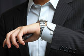 Men's hand with a watch. — Stock Photo