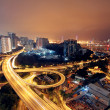 Freeway in night with cars light in modern city. — Stock Photo #7179554