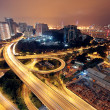 Freeway in night with cars light in modern city. — Stock Photo #7179560