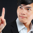 Young business man in a suit pointing with his finger — Stock Photo #7179582