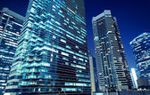 Tall office buildings by night — Stock Photo