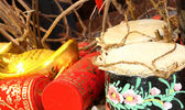 Firecrackers and a Chinese Traditional Wooden Drum — Stock Photo