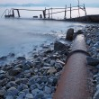 Old metal pipe and road to sea — Stock Photo #7348200