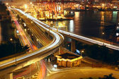 Overpass at night through the port — Stock Photo