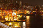 Container terminal at night in city — 图库照片
