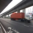 Speed container car moving under the overpass - Stock Photo