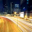 Stock Photo: Colorful city night with lights of cars motion blurred in hong k