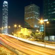 Colorful city night with lights of cars motion blurred in hong k — Stock Photo