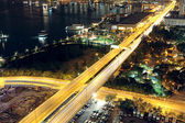 Traffic in modern city at night — Stock Photo