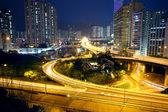 Urban area dusk, busy traffic — Stock Photo