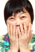 Asian woman use hand cover her mouth — Stock Photo