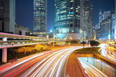 Traffic night in downtown area — Stock Photo