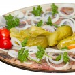 Herring with an onions and pickled vegetables — Stock Photo