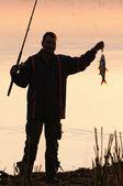 рыбак силуэт — Стоковое фото