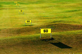 Driving range on golf course — Stock Photo