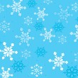 Beautiful snowflakes on a blue background. — Stock Vector