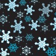 Wektor stockowy : Beautiful snowflakes on black background.