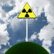 Sign of radiation on the lap of nature. 3D image — Stock Photo #7306793