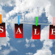 Labels with sale on sky background. 3D image - Stock Photo