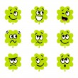 Stock Vector: Cartoon four leaf clovers with facial expression