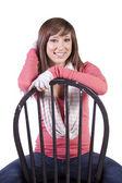 Artistieke foto van een vrouw zitten op een stoel — Stockfoto