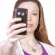 Woman taking pictures from her cell phone — Stock Photo #7086344