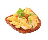Scrambled eggs on fried bread and — Stock Photo