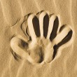 Hand print in the sand - Stock Photo