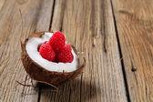 Coconut and raspberries — Stock Photo
