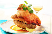 Roasted chicken and baked potato — Stock Photo