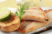Pan fried fish fillets and potato — Stock Photo
