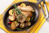 Roasted chicken wings and potatoes — Stock Photo