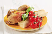 Roast chicken and crispy baguette — Stock Photo
