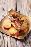 Roast lamb chops and potatoes — Stock Photo