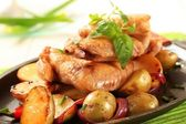 Chicken wings and potatoes — Stock Photo