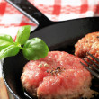 Pan frying patties - Foto Stock