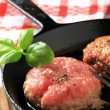 Pan frying patties - Stok fotoğraf