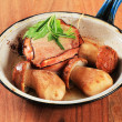 Stockfoto: Bacon-wrapped pork fillet and mushrooms