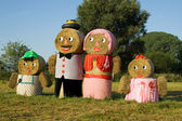 Four figures made out of straw bales — Stockfoto