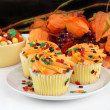 Fall decorated cupcakes and Halloween candy — Stock Photo